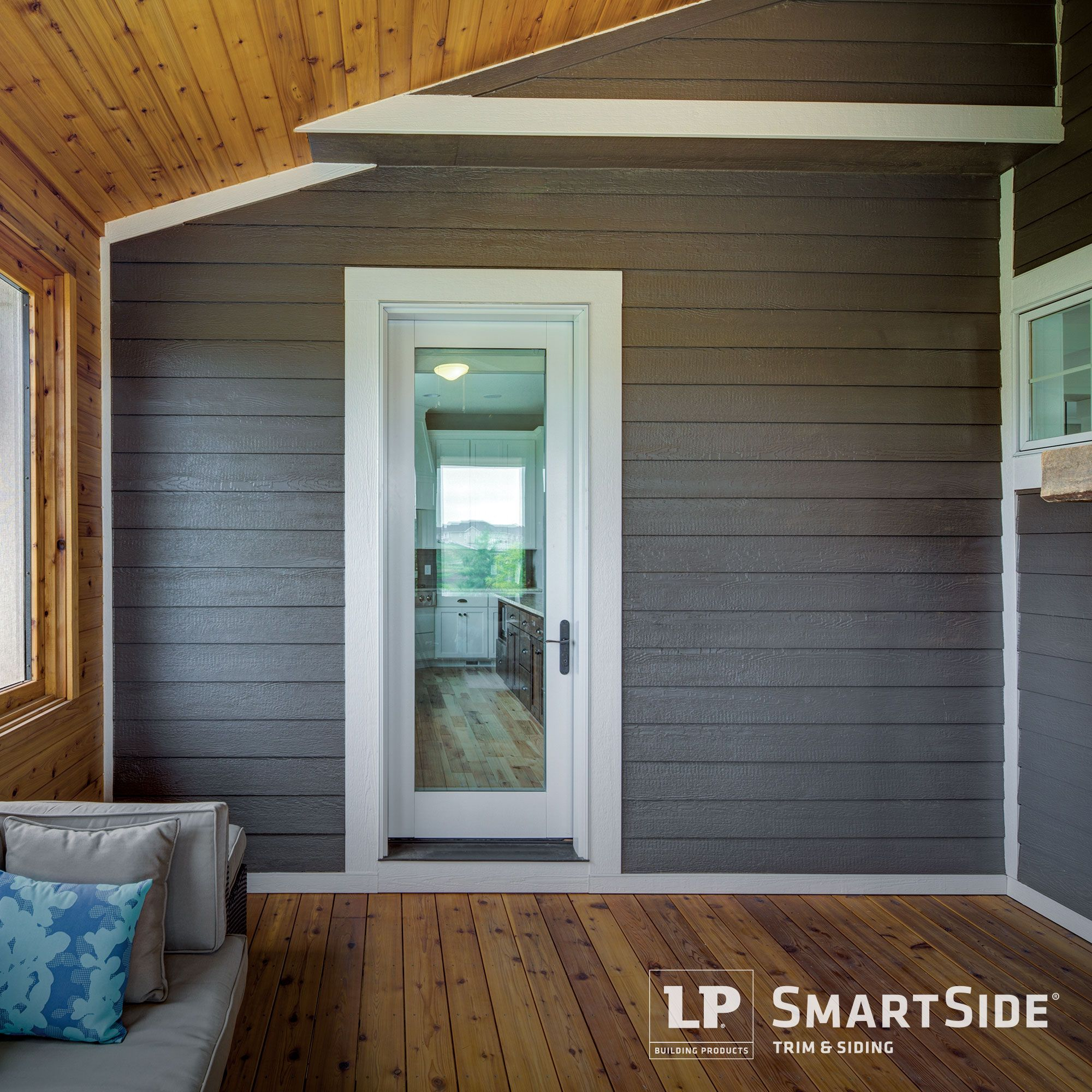 This Porch Outfitted With Lp Smartside Trim And Lap Siding Is Perfect For Cozying Up With A Cup Of Cocoa And A Go Siding Options House Exterior Exterior Siding