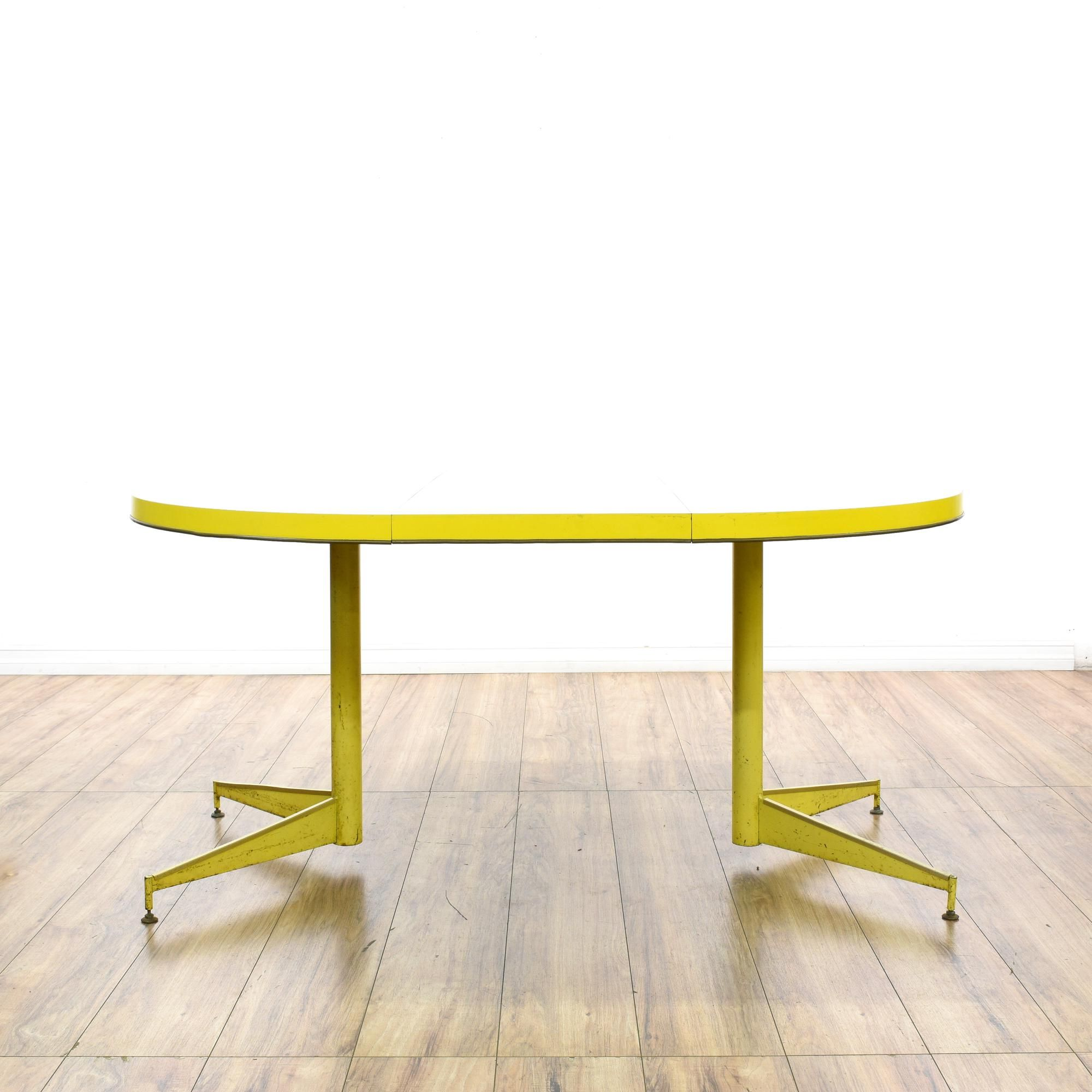 this retro dining table is featured in a durable metal with a