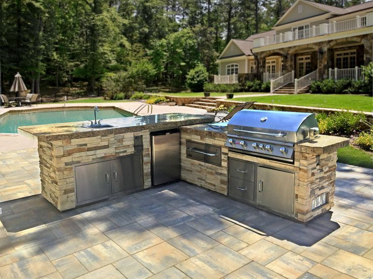 beautiful l shaped outdoor kitchen island with bull components on poolside patio prefab on outdoor kitchen island id=81342
