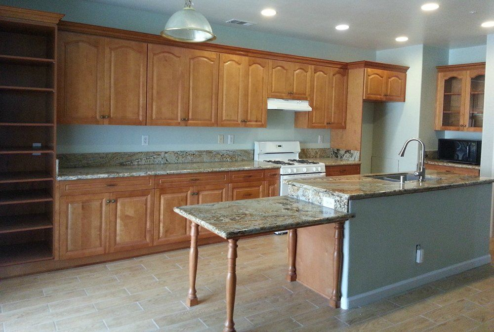 Toffee Arch Cabinets With African Canyon Granite Island Extended To Make A Dining Table Cabinets And Countertops Cabinet Kitchen