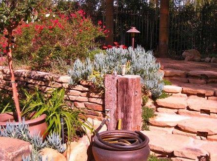 Hide Your Garden Hose In An Attractive Planter