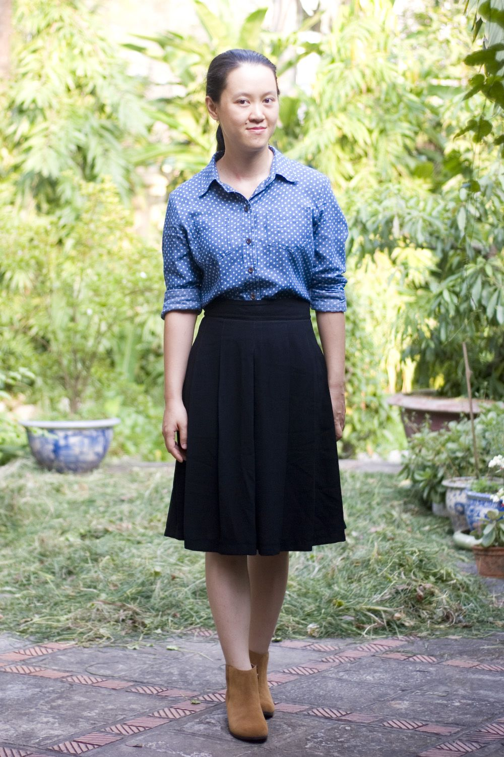 polka dot chambray shirt black pleated skirt brown booties by 14 shades of grey