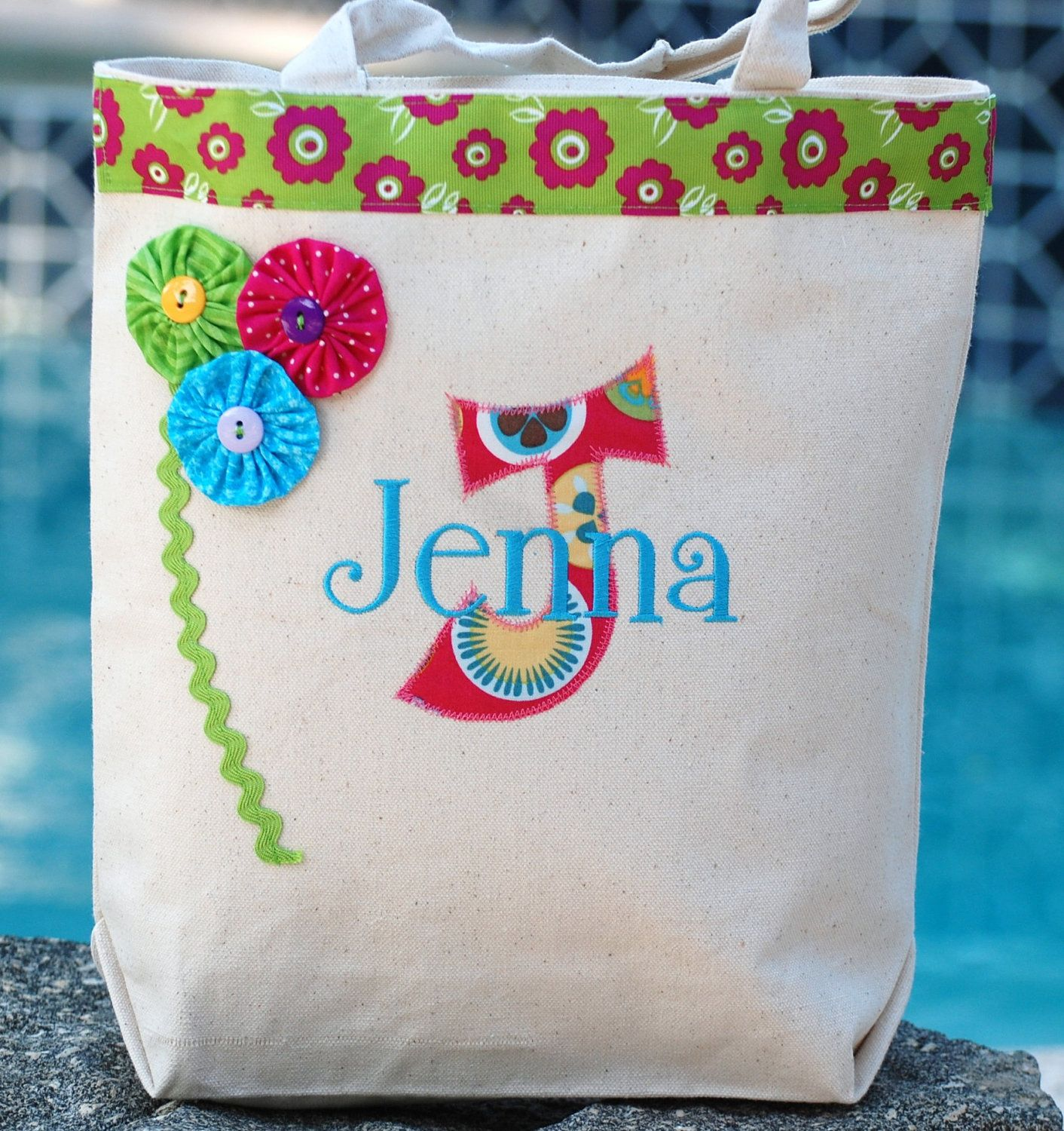 Girls personalized BRIGHT appiqued canvas flower girl tote bag great birthday bag beach bag overnight bag. $24.99, via Etsy.