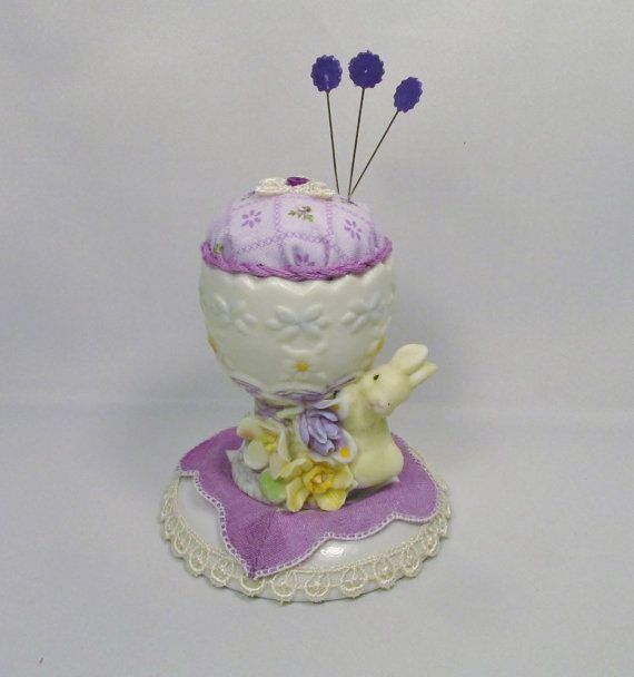 This item is an adorable recycled egg cup with a bunny and flowers at the base…