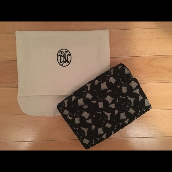 ⭐️ NM Black Lace Clutch ⭐️ Neiman Marcus black lace over white clutch. Spacious and fashionable making it the perfect clutch ! Neiman Marcus Bags Clutches & Wristlets