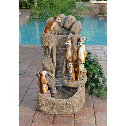 """30"""" Classic Wildlife Meerkat Family Watering Hole Home Garden Water Fountain by XoticBrands. $271.29. Cast in quality designer resin. Youll enjoy the sparkling water every bit as much as this adorable gang of seven social meerkats out for a refreshing splash in their Kalahari Desert watering hole! Our charming, almost three-foot-tall fountain is cast in quality designer resin and realistically hand-painted for home or garden in the true colors of natures beauty. ..."""