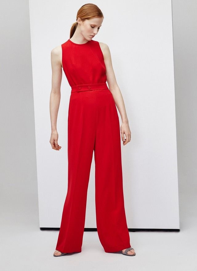 Adolfo Dominguez Stylish crêpe, sleeveless jumpsuit red featuring a crew neck and a fixed belt with button detailing at the waist. It has wide-cut legs and a concealed zipper fastening at the back.