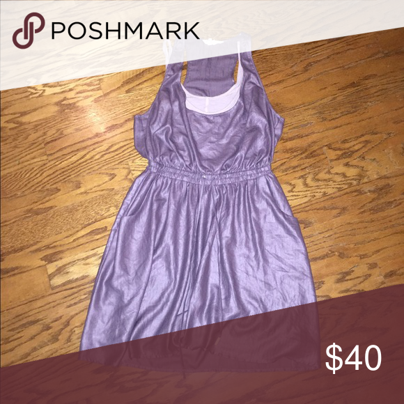Shimmer purple dress Shimmery purple dress with a lighter purple attached tank part underneath. Has elastic in the middle with ties and pockets. BCBGeneration Dresses