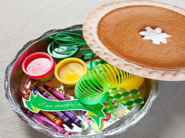 Faux Pumpkin Pie filled with non-food treats and toys. Keeps kids entertained at the dinner table and let's mom  and dad enjoy their meals!