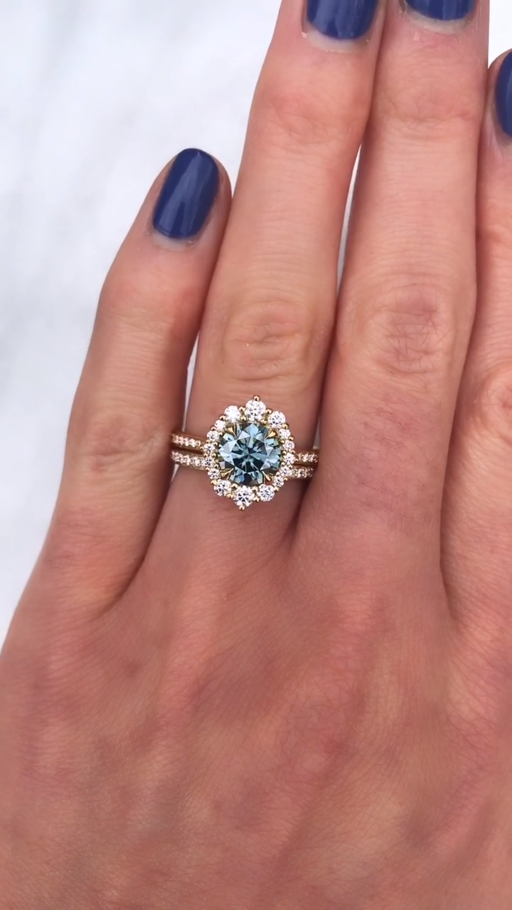 The vintage-inspired aqua-teal Emerson halo ring