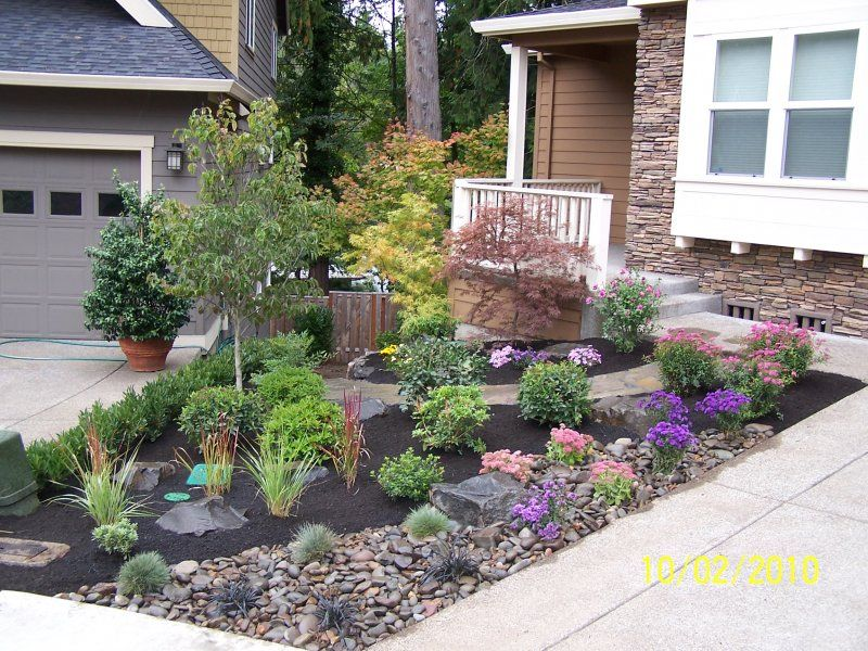 dark grey rock landscaping ideas for front yard on black ground and