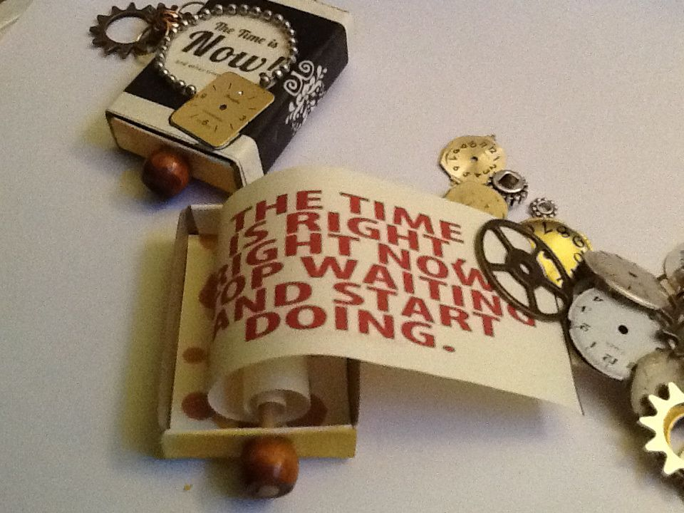 altered matchbox with steam punk elements and a scroll book with Time quote