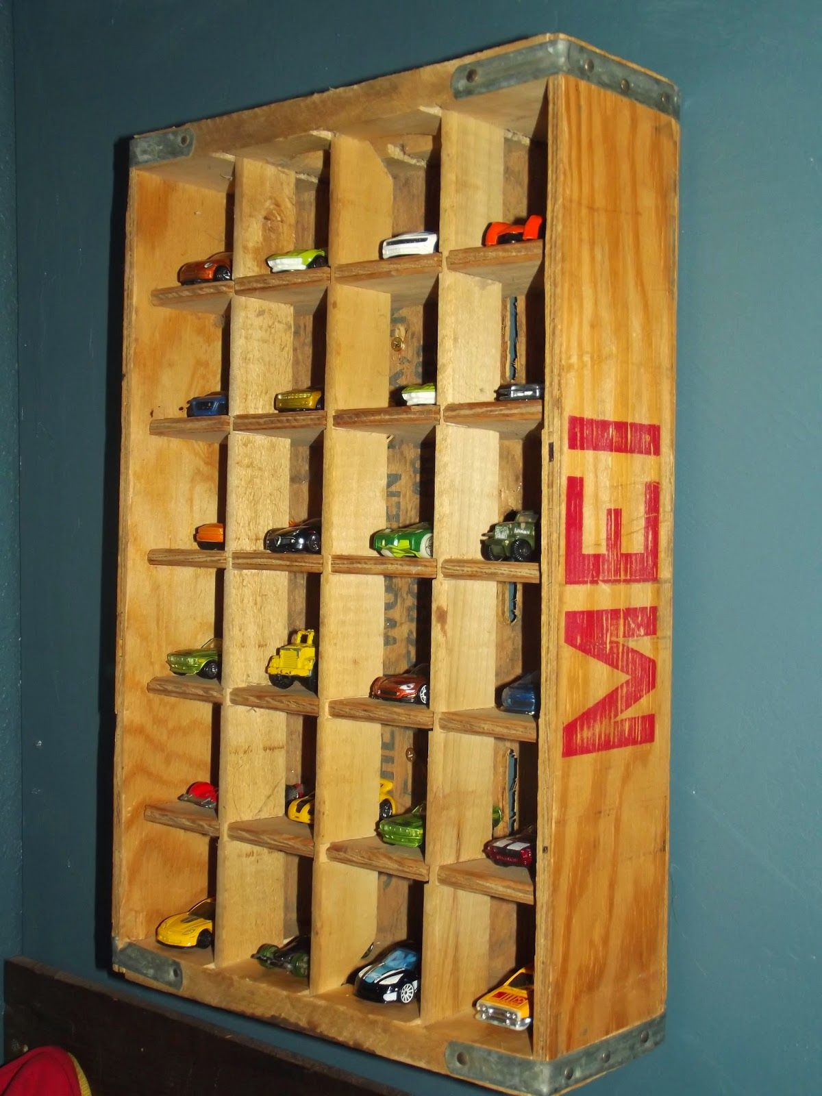 Vintage crate used as a holder for your little boys hot wheels my boys are