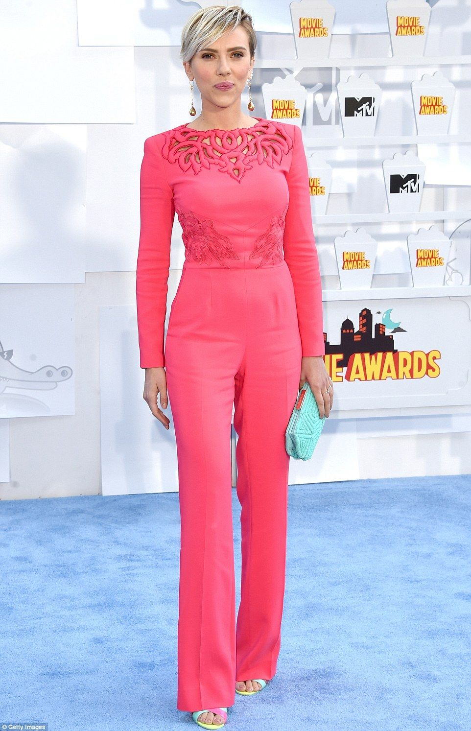 762c0568954 ... MTV Movie Awards. Nice color  The Avengers star stood out in a coral  jumpsuit that hugged her curves.
