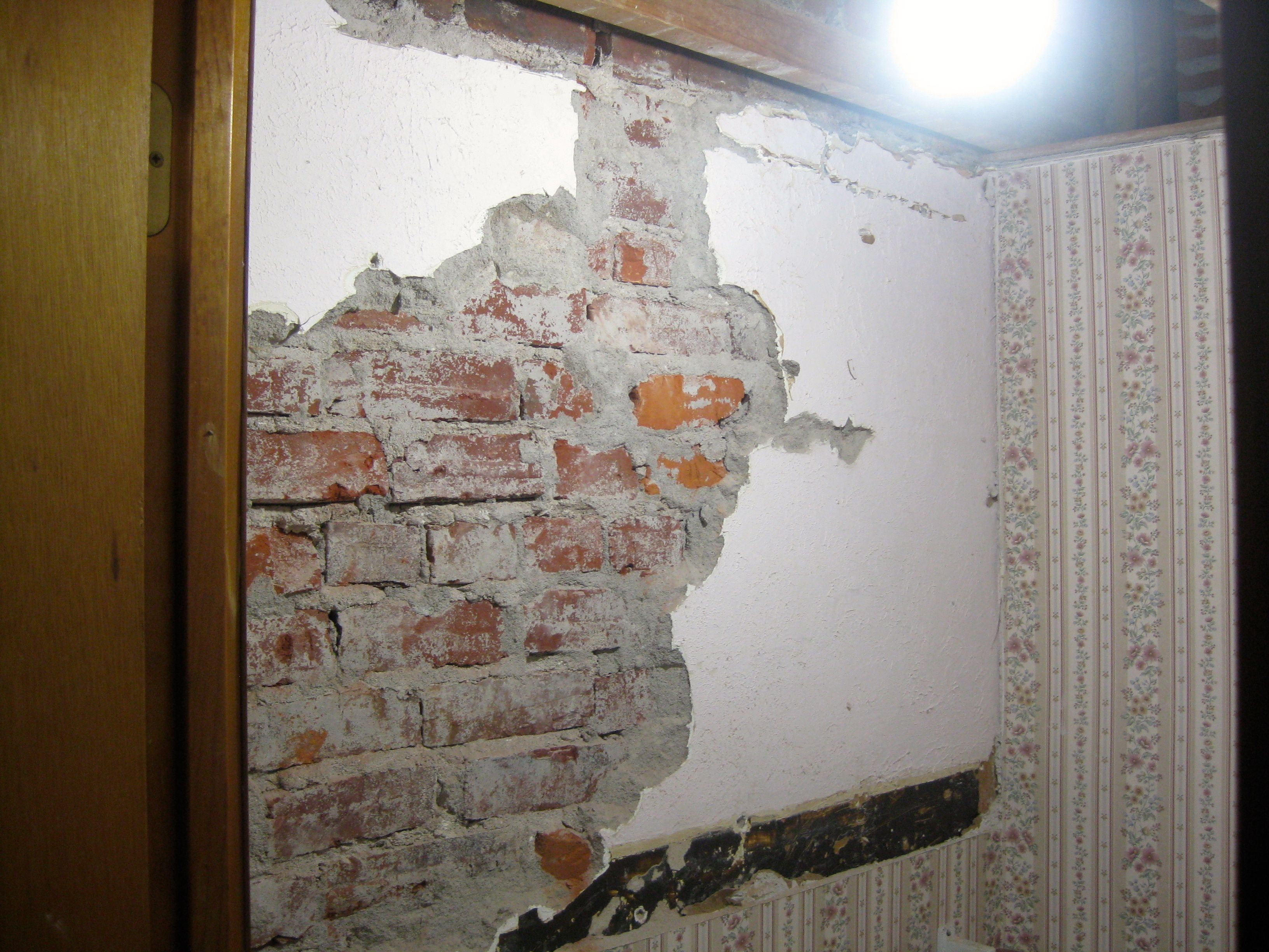 Chiseled off the plaster to expose the brick wall brick