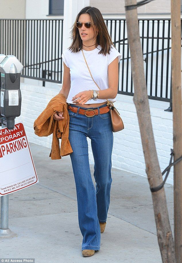 Alessandra Ambrosio shows tum in crop top and bell bottom jeans ...
