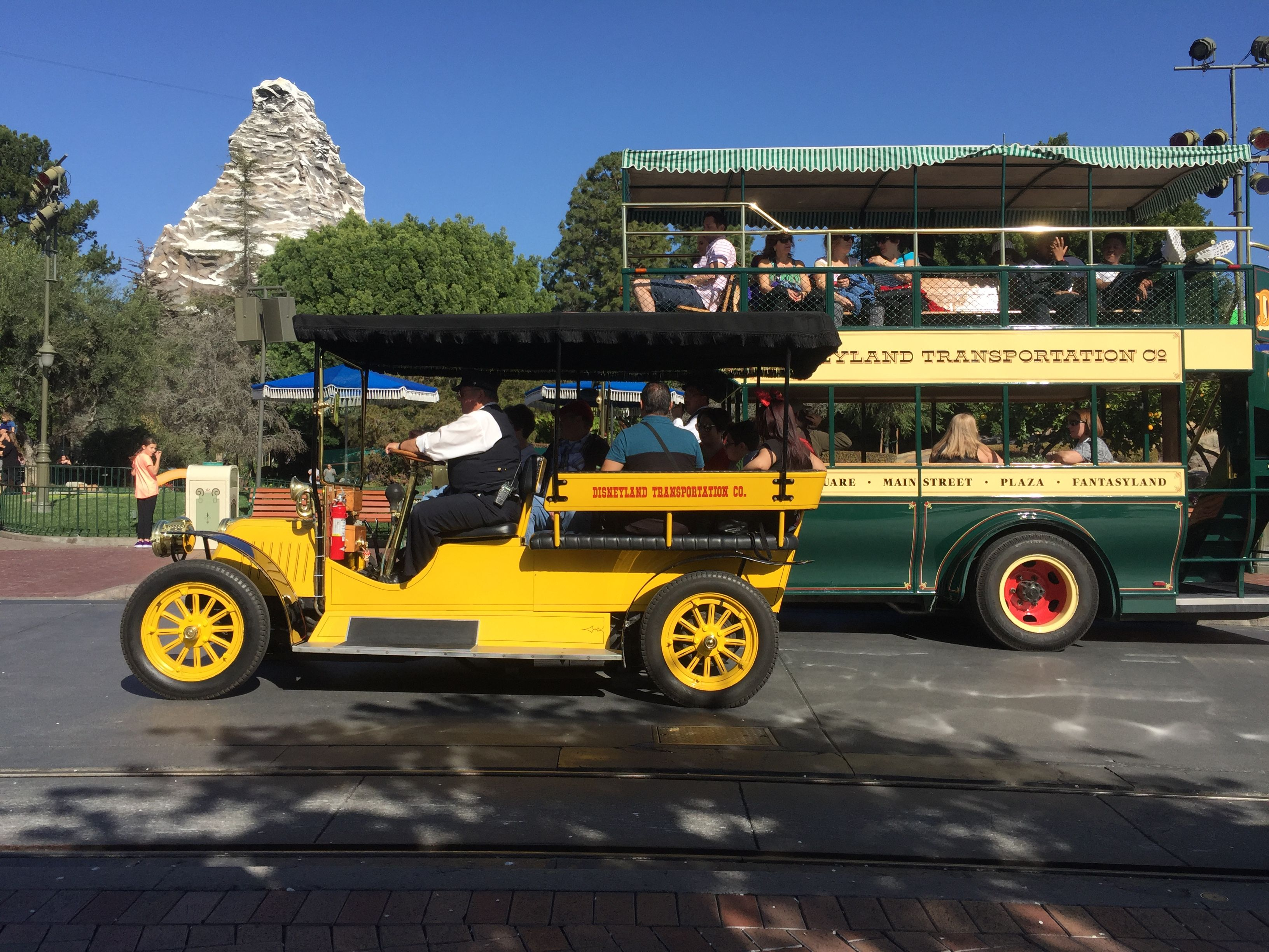 Disneyland Main Street vehicles The yellow car and Omni bus