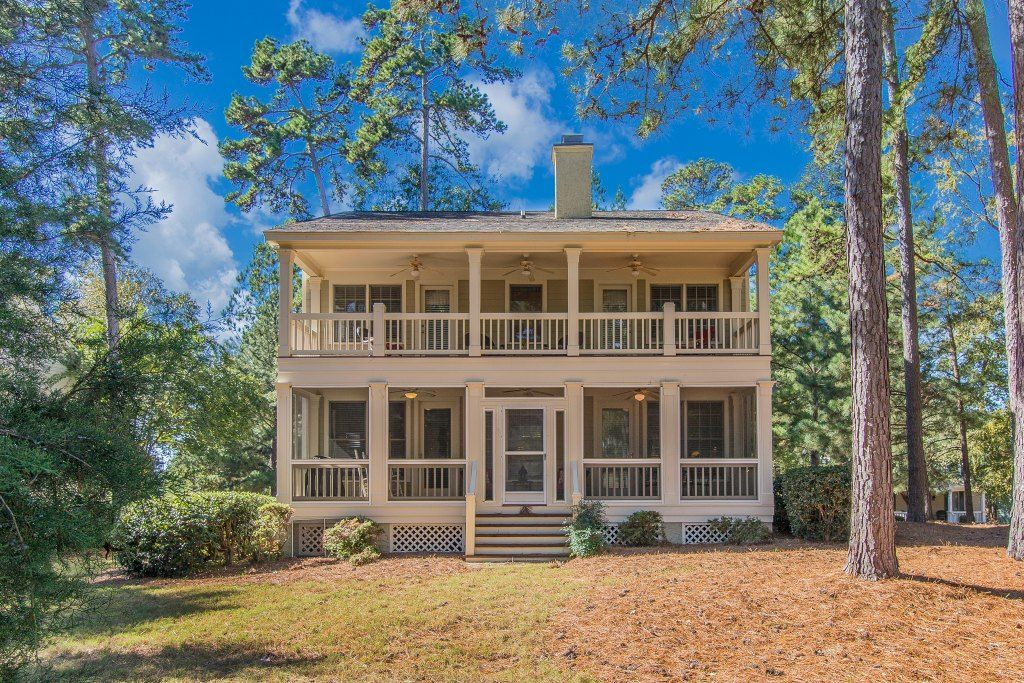 JUST LISTED by The Vining Group! Golf course cottage in
