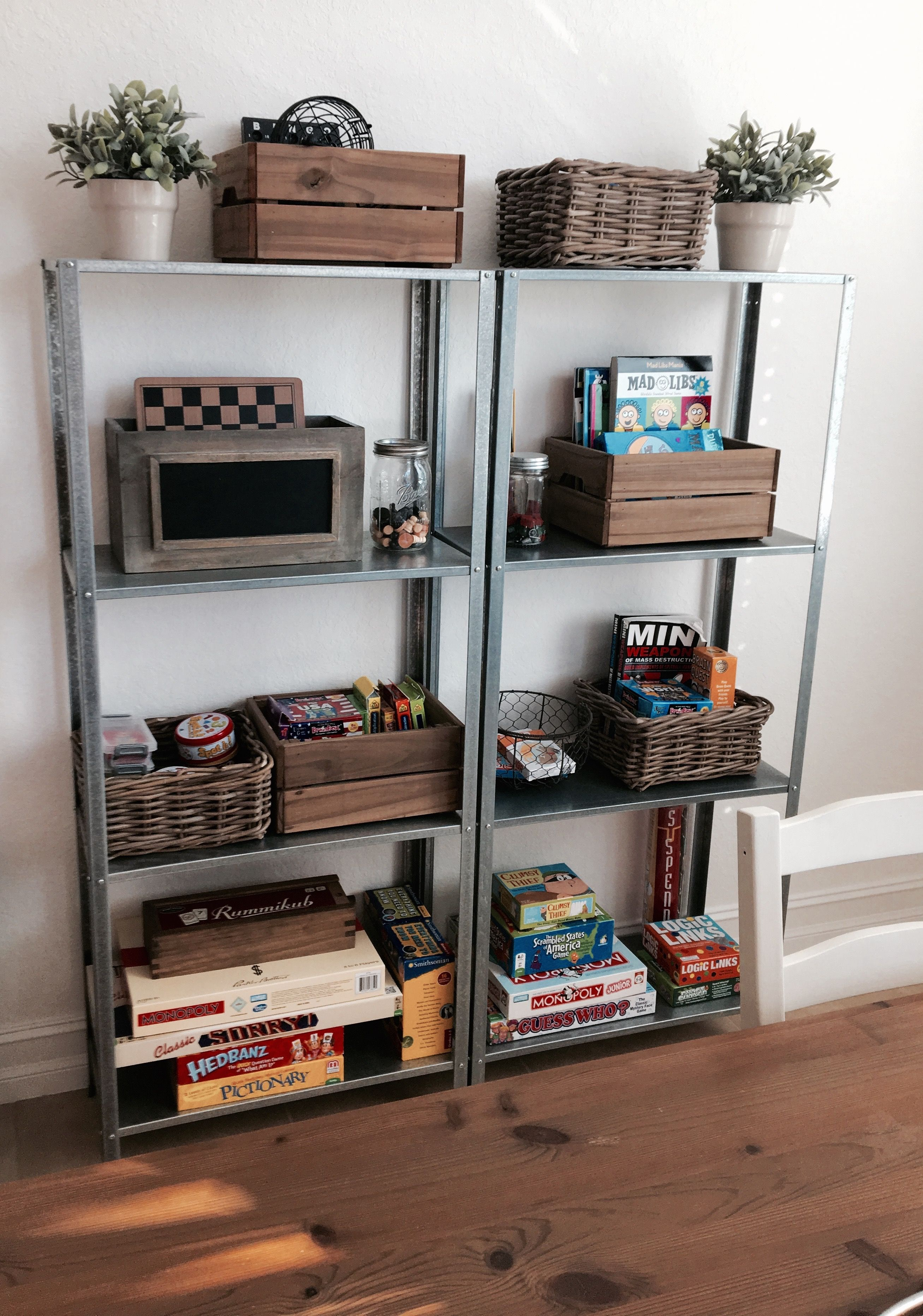Ikea metal shelving with wood and basket decorations / board game shelving