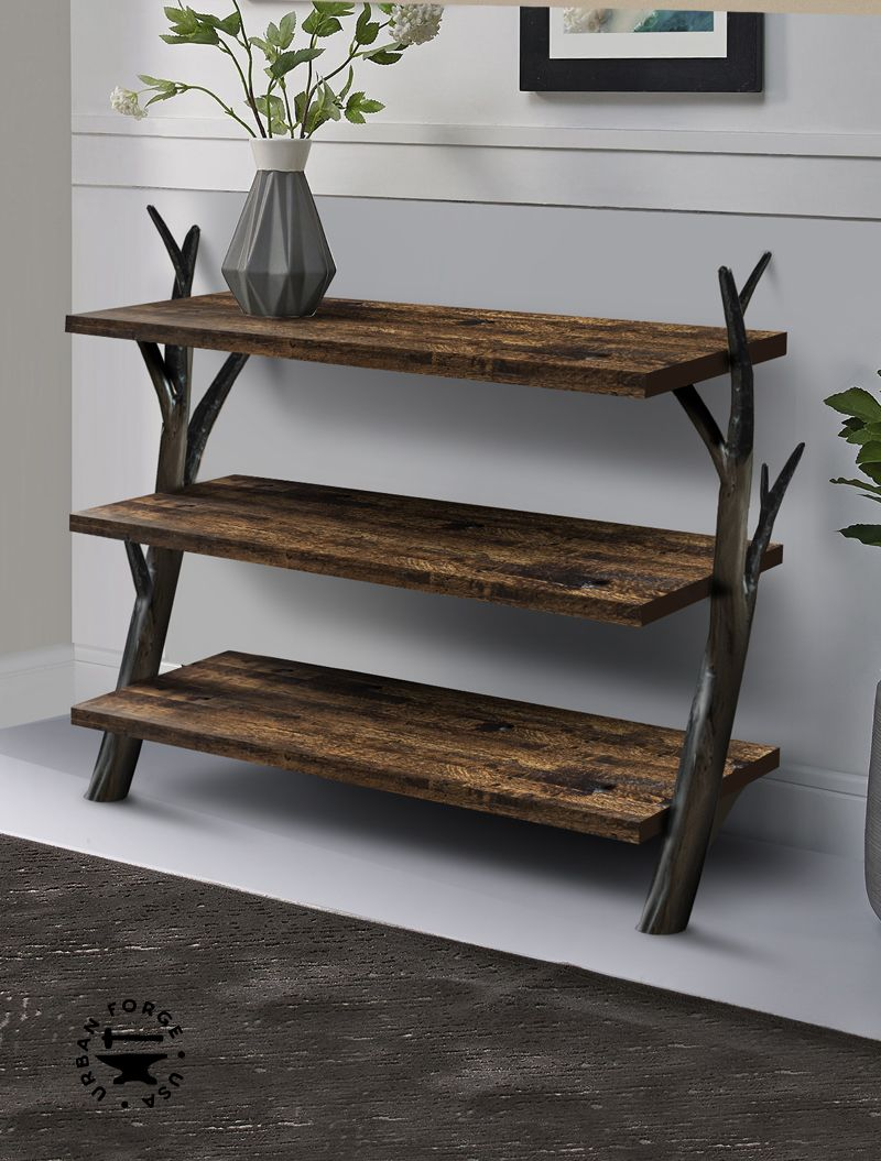 American Forged Tree Branch Low Bookshelf - This sculptural branch bookshelf is a warm statement piece. The hidden feet under the bottom shelf make this bookshelf freestanding for use anywhere in your space.