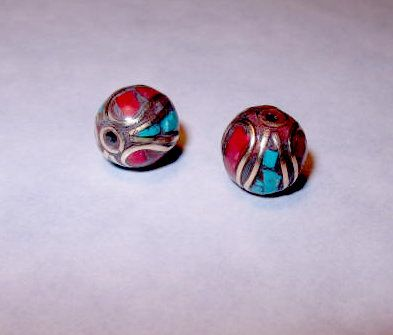 Steal the deal!  This listing is for two beautiful handmade Nepal beads.  They are made of brass and inlaid with colorful stone clips.  2 for $8.99 Item Description  Brand Name: Tibet story Material: Metal Item Diameter:10-11mm Item Shape: Round Shape Item Weight:3-5g Feature: Nepal metal jewelry loose beads Metal: brass Inlaid: red coral, turquoise clips