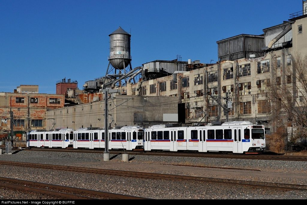 Denver's RTD light rail train runs past the dormant Gates