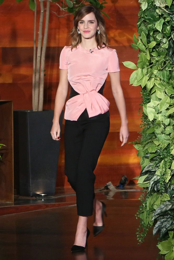 b69f7f846ea5 Emma Watson s Beauty and the Beast Eco-Friendly Outfits - Oscar de la Renta  pink top and black pants