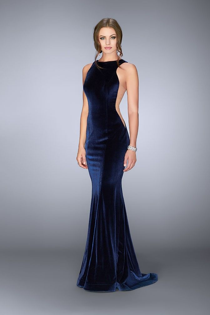 db9f25bc6a There is no denying that the hottest trend right now is velvet. Step out in  high style with this sleek form fitting floor length velvet gown.