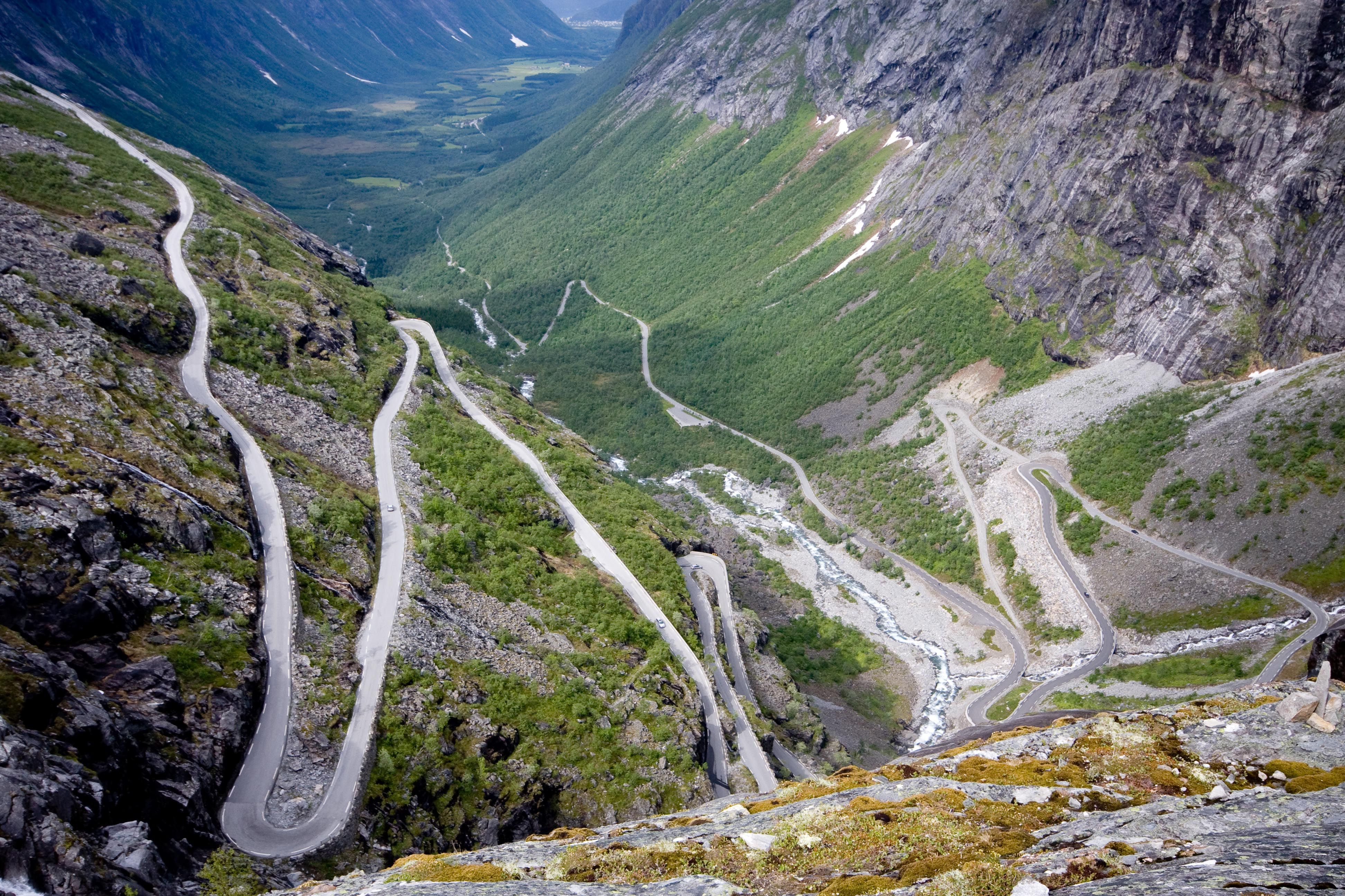 "Trollstigen is a road thru the mountains of Norway's Rauma area that is famous for it's 11 twists & turns as well as for it's steep incline.  The name mean's ""Troll's Ladder"". It crosses over the Stigfossen waterfall bridge with a viewing platform.  Road closed in winter."
