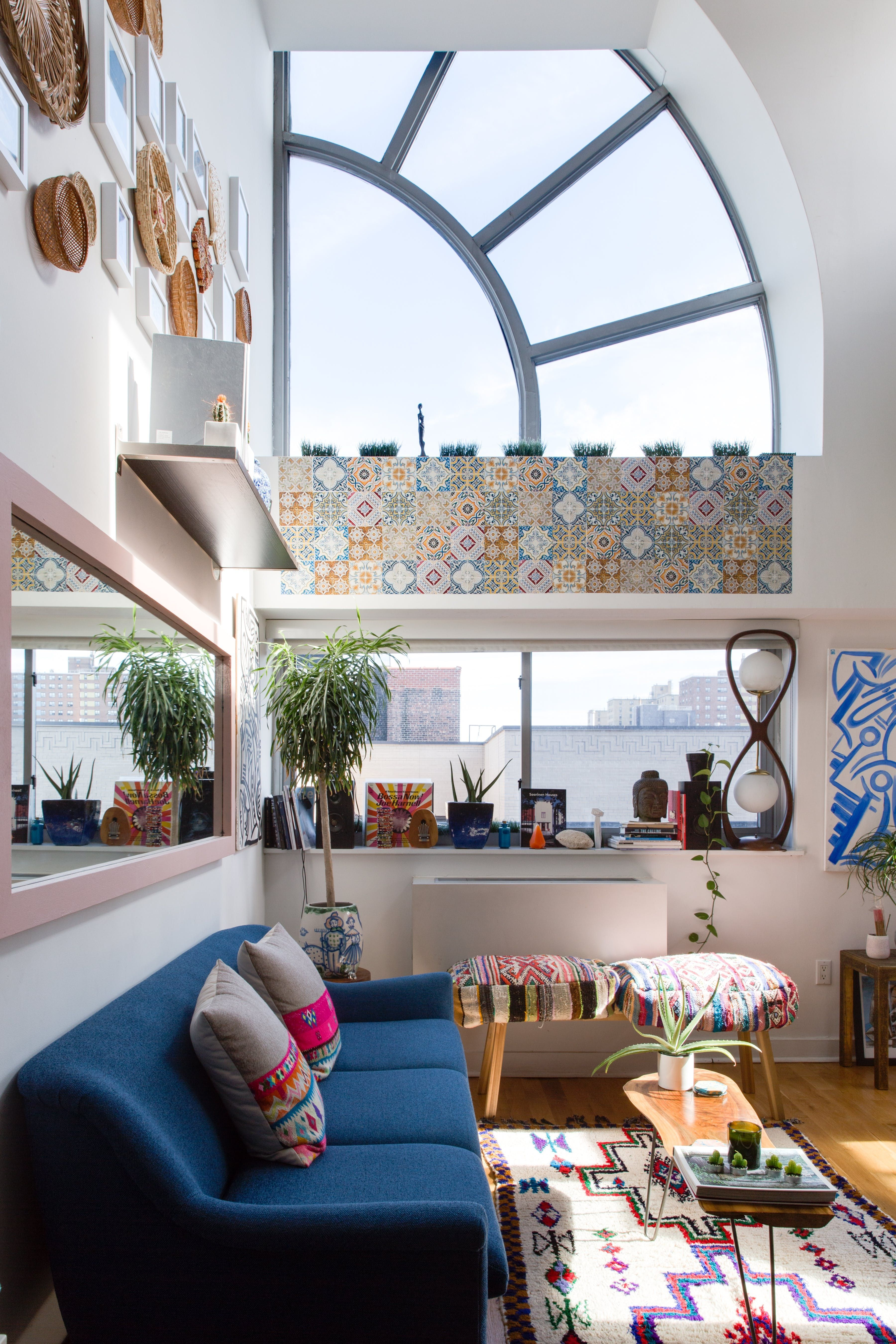 Big windows eclectic bright and playful living room manhattan new york apartment living moving in together