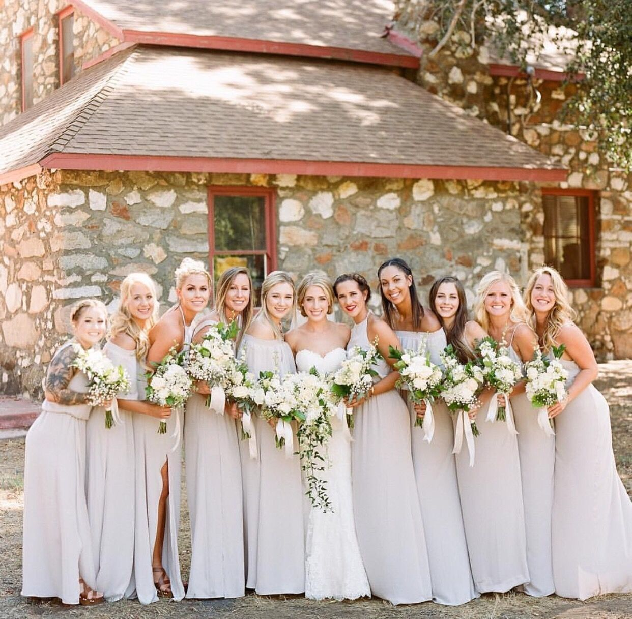 Beautiful Bride And Her Bridesmaids All Dressed In Show Me The Ring Crisp Bridesmaid Dresses