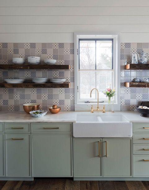 A modern farmhouse kitchen with rustic decor and bohemican chic. Open wood shelves, handpainted tile backsplash, green cabinets, shiplap, and an apron front farm sink. Design: Jennifer Bunsa. #shiplap #kitchendesign #modernfarmhouse