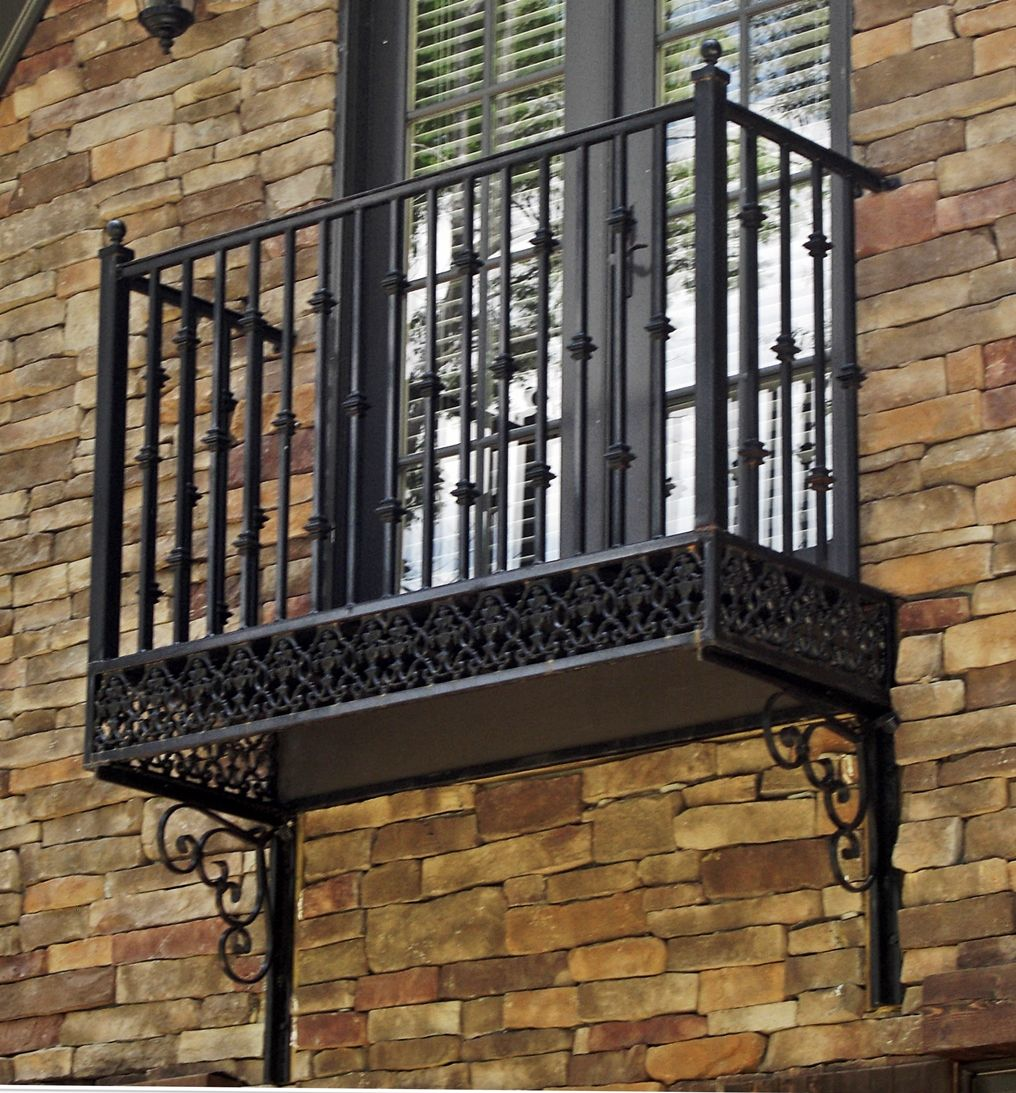Wrought iron balconies this is their for Balcony handrail
