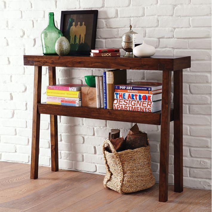 Guestroom side table - warm wood, books, landing strip