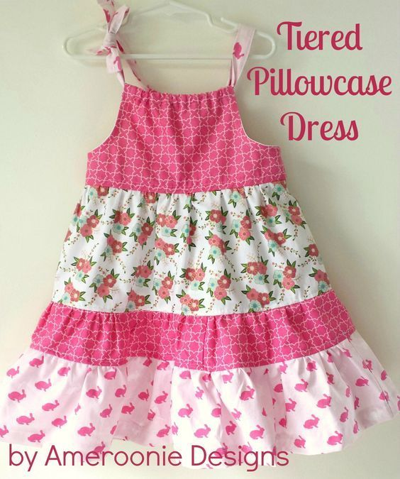 A free sewing tutorial for a tiered pillowcase dress. Cute sewing pattern for a little girls dress. Learn how to make a Tiered Pillowcase Dress.