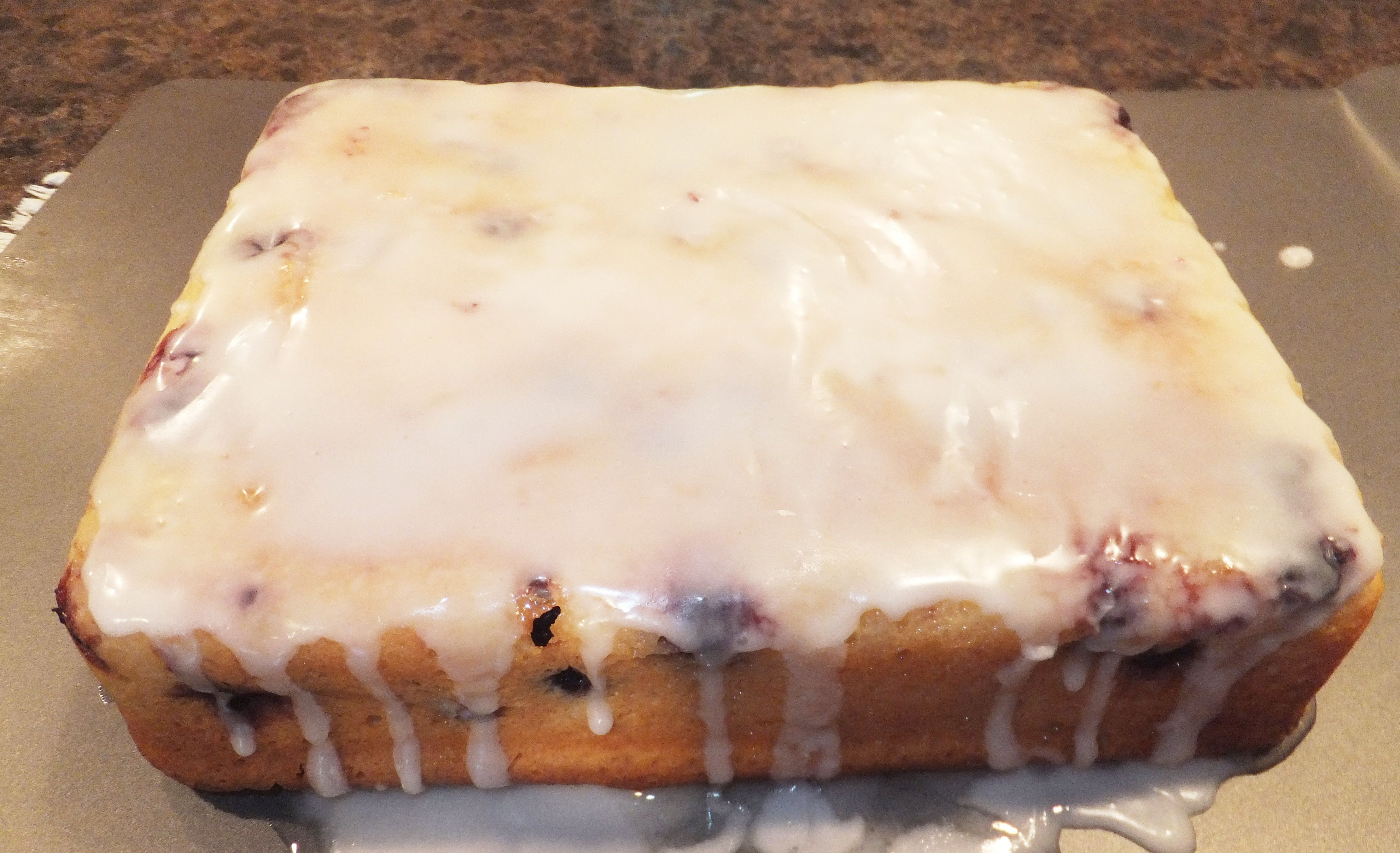 Blueberry sour cream loaf with lemon syrup and glaze