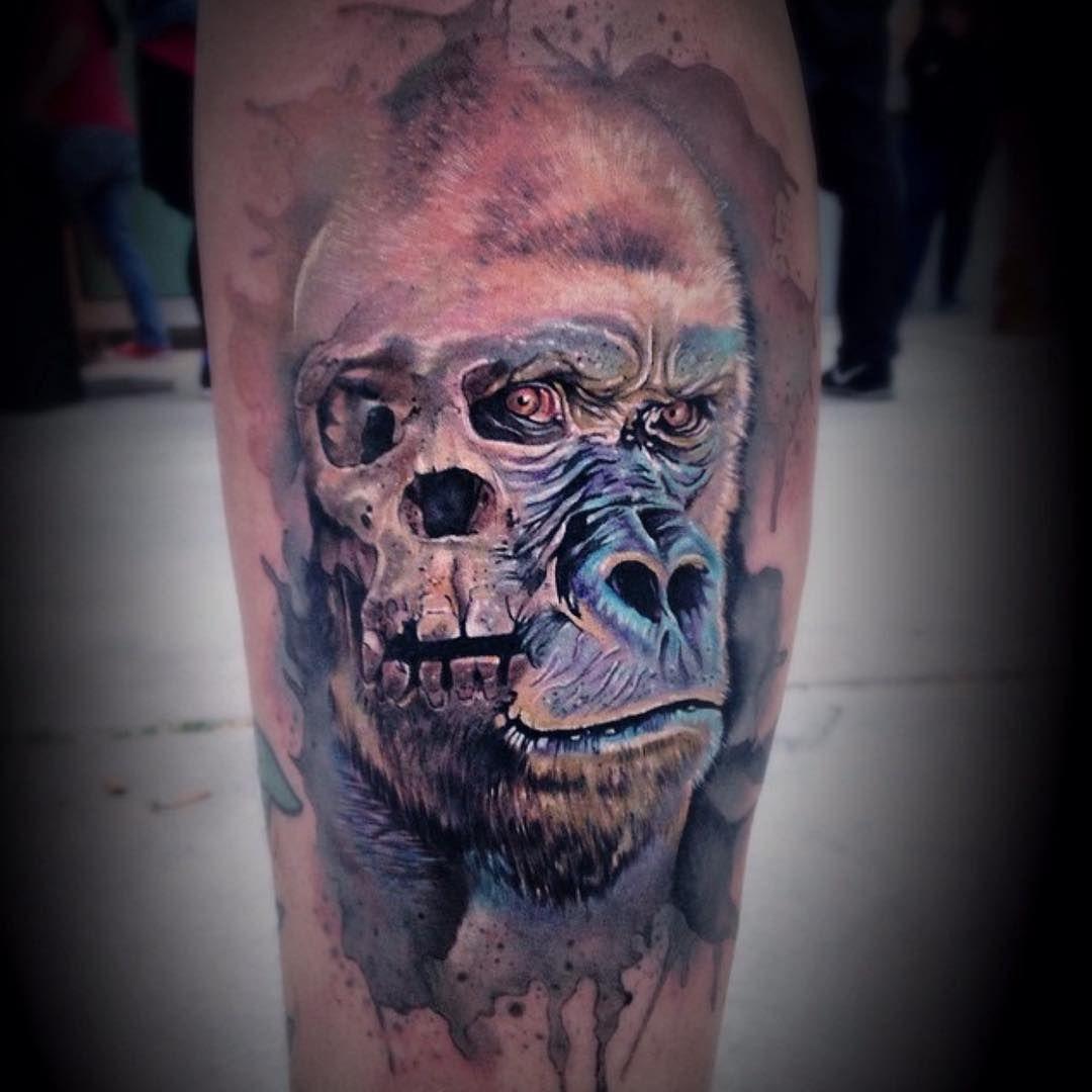 black and grey gorilla tattoo on the right lower leg shin