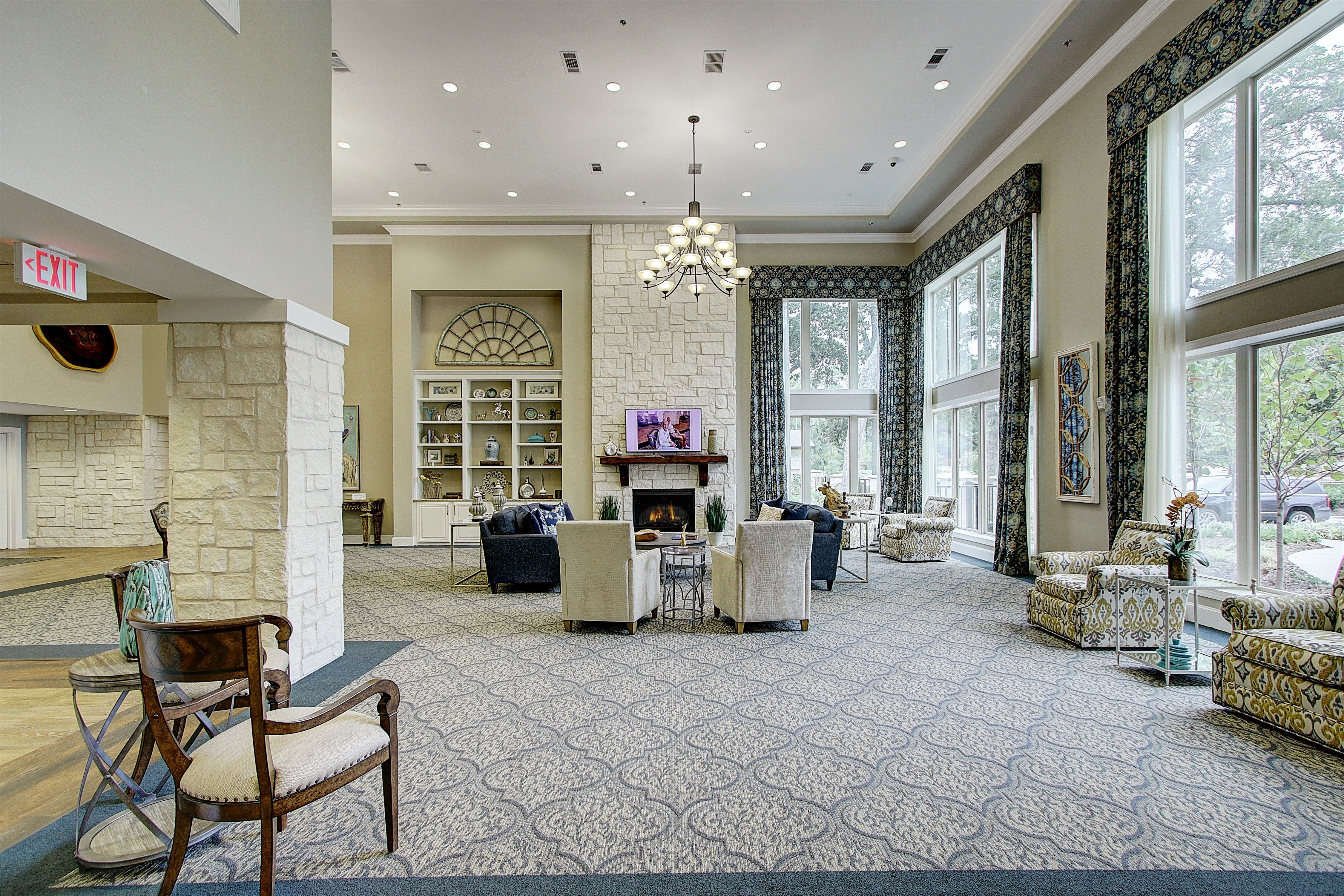 Testimonial Reviews For Assisted Living And Memory Care Cozy Interior Senior Living Floor To Ceiling Windows