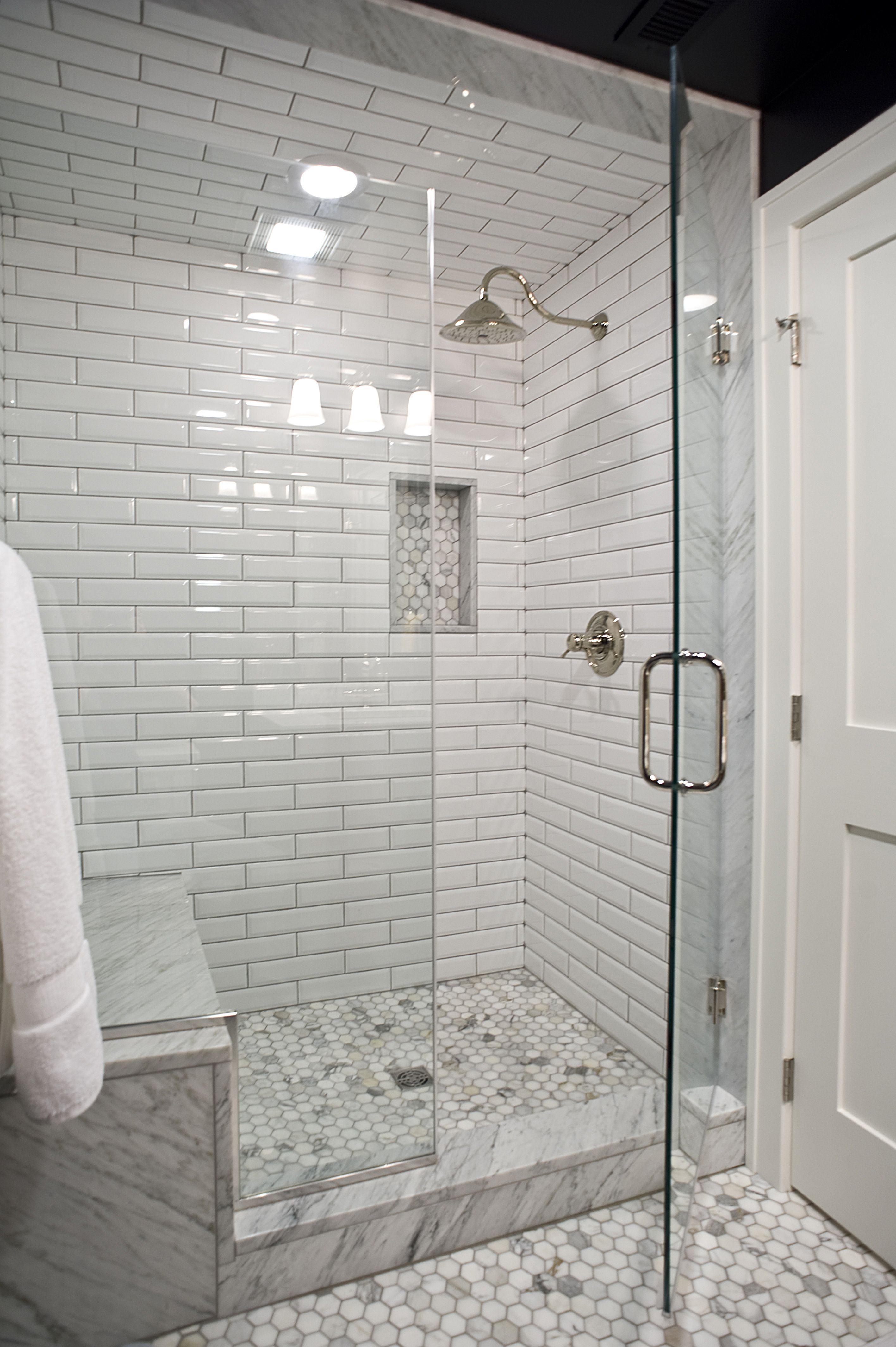Lower Level Guest Bathroom  remodel by Vivid Interior marble tile ceramic subway tile glass