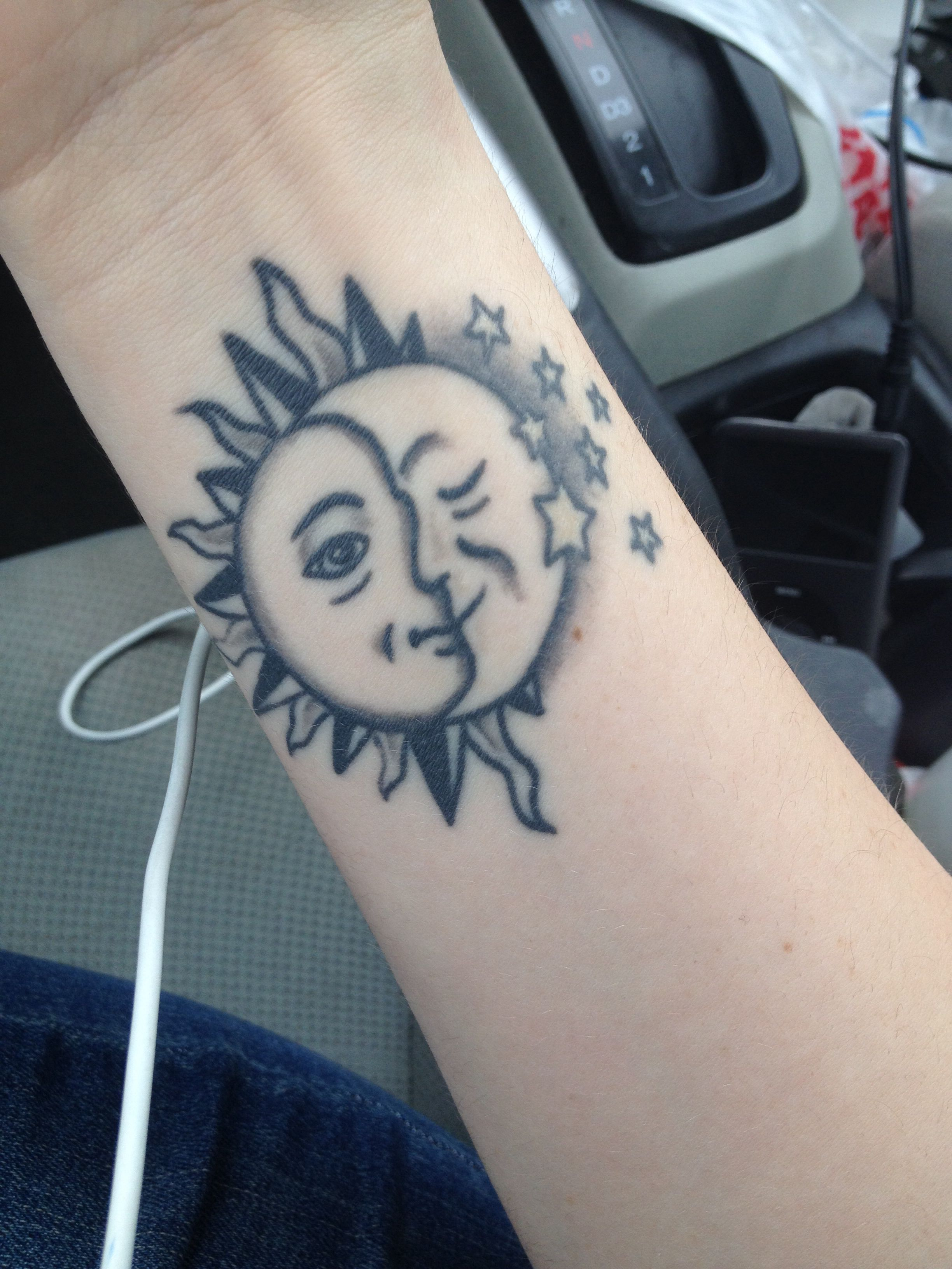 Sun & Moon Tattoo. I'd change a couple things and add some