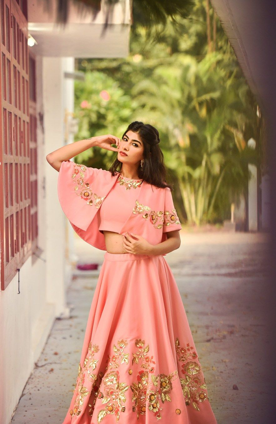 82b3508ba0 Love this peach pink cape style lehenga by Puwin Couture Surat #Frugal2Fab