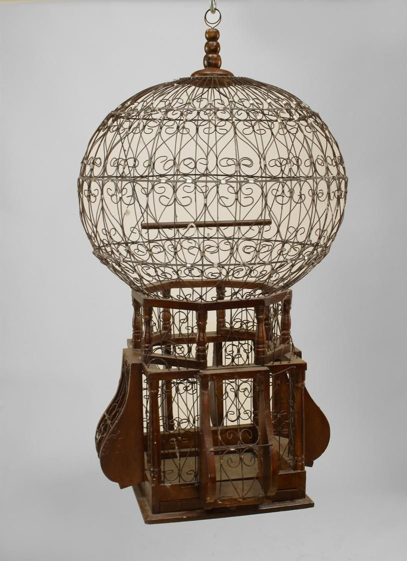 | English Victorian style (20th Cent) bird cage with scroll wire balloon form over a square wood base
