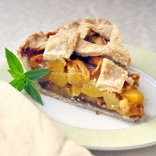 Perfect Peach Pie - Isn't she a beauty? I wait every year for the height of peach season to make my favorite summer fruit pie. There's simply nothing like a fantastic peach pie; a definite slice of summer.