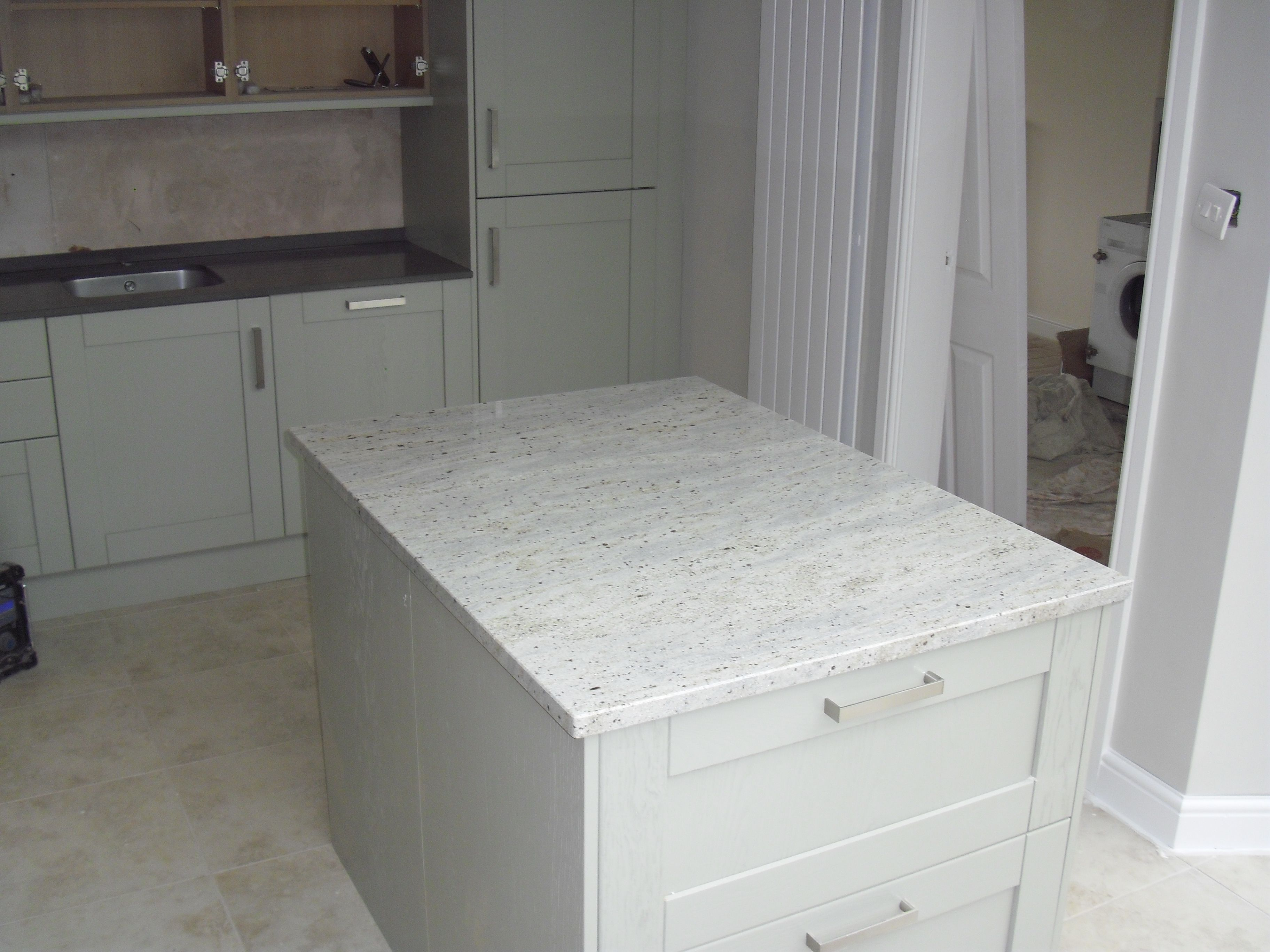 Kashmir White granite makes a great feature of this small island ...