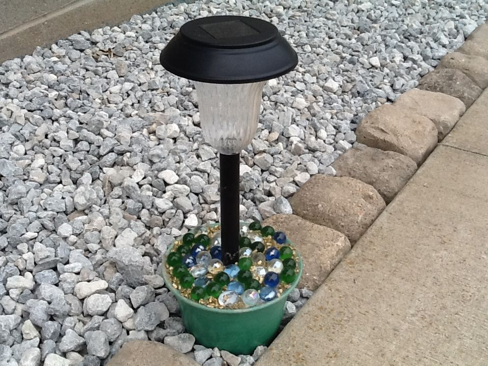 Put A Solar Light In A Pot Full Of Concrete Decorate With
