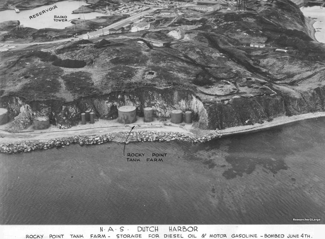 General view of Naval Air Station (NAS) Dutch Harbor before the attack. Hangar and tarmac for amphibious patrol aircraft is under construction in center top