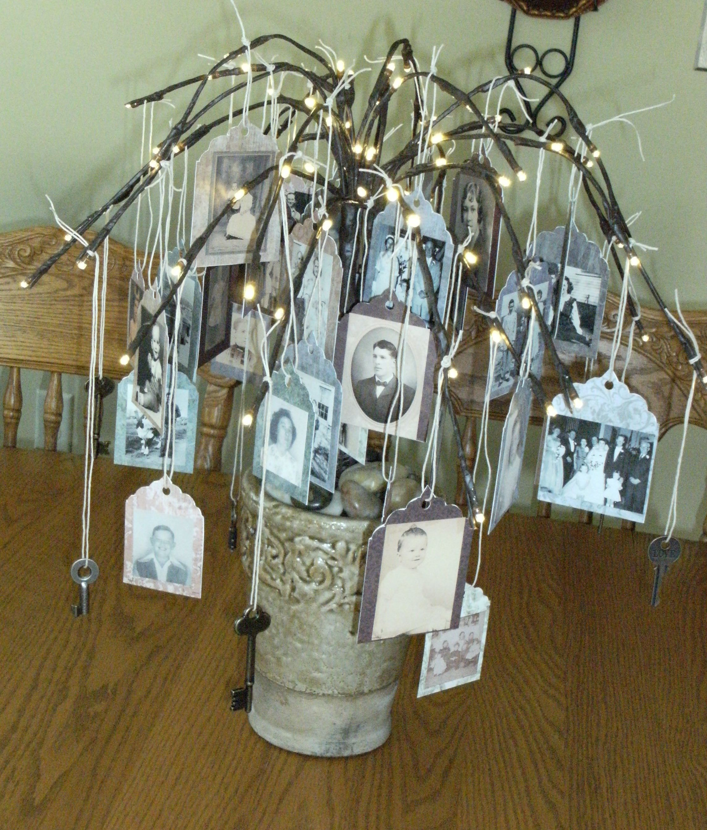 Family tree centerpiece created by using lighted twigs