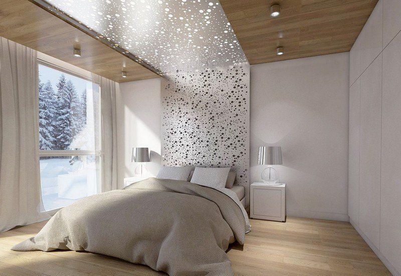 Bett-Kopfteil aus Lochblech, weiße Wände und Bettwäsche in neutralen ...