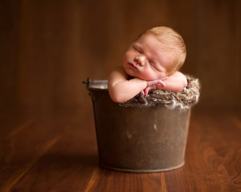 Baby in a pail. sweet. beautiful lighting