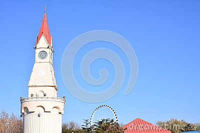 The clock tower built a very strange, European style architectural style, with the background of the blue sky, the formation of a beautiful picture.